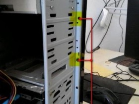 电脑主机箱前机板怎么拆?